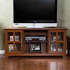 @Overstock - This Highland Mission media stand features a rustic charm with a contemporary style with tempered glass doors. This stand fits up to a 50-inch flat panel TV and showcases a beautiful oak finish.http://www.overstock.com/Home-Garden/Highland-Mission-Oak-Media-Stand/4334806/product.html?CID=214117 $313.54