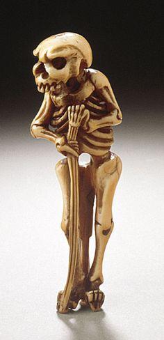 Japan  Walking Skeleton, early 19th century  Netsuke, Narwhal tusk with staining, sumi. LACMA