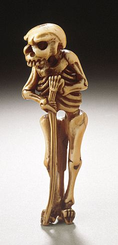 Japan Walking Skeleton, early 19th century Netsuke, Narwhal tusk with staining, sumi. LACMA