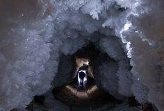 "A man walks through a tunnel formed by ice crystals from surrounding permafrost, outside the village of Tomtor in the Oymyakon valley in northeast Russia, on January 28, 2013. The coldest temperatures in the northern hemisphere since the beginning of the 20th century were recorded in the Oymyakon valley, known as the northern ""Pole of Cold"", reaching a temperature of -67.8 degrees Celsius (-90 degrees Fahrenheit) in 1933."