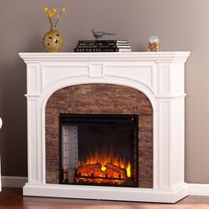 <p>Create a warm and cozy ambiance to your home, whether it's in a city apartment or countryside cottage, with the beautiful Bairdford Stacked Stone Effect Electric Fireplace by Three Posts.</p><p>The frame is made from manufactured wood in a crisp white finish and features a classic brick style interior for a touch of rustic charm, while the paneled details instantly elevate the whole design. Lifelike stacked stone adds extra texture, color, contrast to the frame, and ...