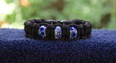 Blue and White Beaded Black Paracord Bracelet   by RainyDayzArt, $12.50 https://www.etsy.com/listing/190910379/blue-and-white-beaded-black-paracord?