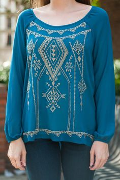 """You'll be so sad when you come back to this beautiful teal blouse only to find it's out of stock! We suggest you go ahead and get your size in this flawlessly detailed beauty before they're all gone because missing out on such a light, easy fit would be a tragedy! Material has no amount of stretch. You might want a cami handy with this one! :) Haylee is wearing the small. Length from shoulder to hem: S- 25""""; M- 26""""; L- 27""""."""