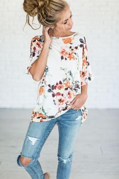 Floral print short sleeve top with ruffle details High low hem Fits loosely 95% rayon / 5% spandex PREORDER: style is expected by 4/1/18