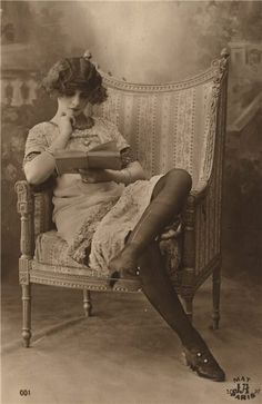 Woman reading. French postcard c1920s.  Books are the quietest and most constant of friends; they are the most accessible and wisest of counsellors, and the most patient of teachers.