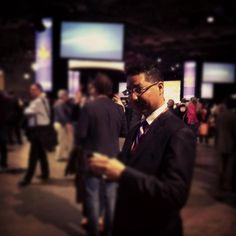 Reporter Richard Madan checking his Blackberry on the NDP Leadership Convention floor on March 23, 2012.