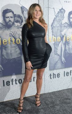 The camera loves her!The 48-year-old looked stunning in a skintight leather dress as she left little to the imagination