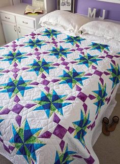 Foundation paper piecing ensures that you achieve perfect star points in this gorgeous full, bed-size quilt called Anna's Starflake, by Nancy McNally. Take advantage of the quilt kit for this project (while supplies last), in order to create your own quilt using the same colorways. If you'd like a refresher course on paper piecing, take a look at our free quilting video tutorial, Sew Easy: Paper Foundation Piecing.