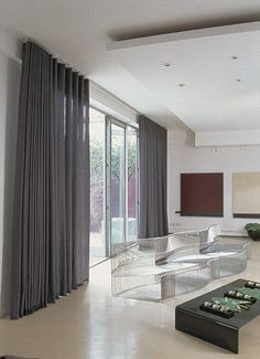Wave curtains in bi-fold doors hand made - made to measure electric or manual house couturier