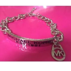 Michael kors dog plate bracelet dog tag logo Michael kors silver plated bracelet. I don't not know if this is real. It's very cute and has name one it adjustable clasps Michael Kors Jewelry Bracelets