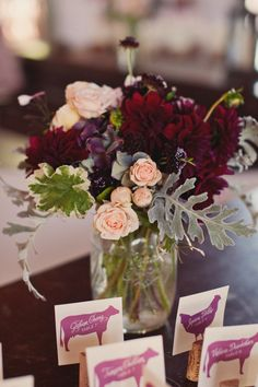 Maybe not the entire design but, dark purple dahlias with dusty miller (silver) and cream spray roses.