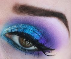Blue shimmer with Purple mac eyeshadow . Fake eyelashes coat with mascara for natual look. Line eye with a blue eyeliner. Fill eyebrows