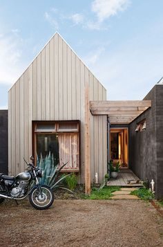 obsessed with this Australian home // light wood siding