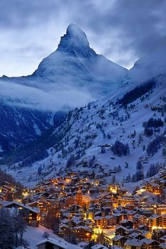 The Matterhorn towers over the village of Zermatt in the Swiss Alps. Zermatt is a beautiful area with fantastic skiing, and the Matterhorn is stunning 365 days of the year. I'd highly recommend it for a ski trip Zermatt, Places Around The World, The Places Youll Go, Places To See, Around The Worlds, Stations De Ski, Swiss Alps, Future Travel, Dream Vacations