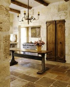... in my kitchen like in Italy..old doors, stone floor, rough stone walls