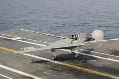 An X-47B conducts a touch and go landing.