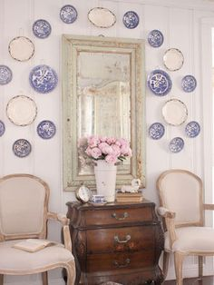 Blogger Courtney from French Country Cottage wanted to combine shabby chic, classic cottage, and French country styles when decorating her California home. For the sitting area, she chose to adorn the walls with blue-and-white willow patterned transferware and rustic linen Louis XVI chairs for a cozy and weathered nook. - CountryLiving.com