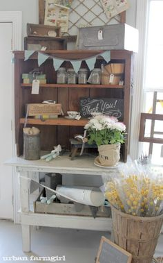 teal banner on wooden shelving maybe bookcase?