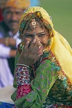 Photo about Indian lady in traditional costume covering her face and laughing at the annual elephant festival in Jaipur, Rajasthan, India. Image of laugh, cover, beauty - 10367148