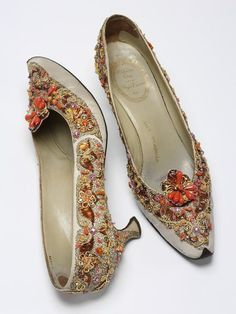 Pair of evening shoes, Paris, France 1958-1962 (made)   Roger Vivier, born 1913 - died 1998 (designer)  Christian Dior (designed for)   Embroidered silk grosgrain with pastes, silver and gold metal thread, brilliants and beads