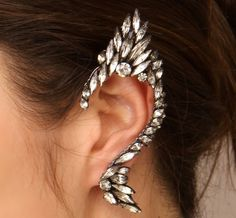 sparkly elf ear earring.