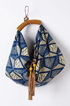 "Legend & Song Dutch Wax Hobo Bag By Mille Collines Tie closure Cotton; cotton lining 14""H, 18""W, 2""D 11"" strap drop Handmade in Rwanda"