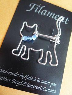 ETSY:  Heather Boyd - Wire  . . . . .  https://www.etsy.com/listing/37871835/cat-brooch-blue-collar