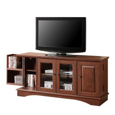"52"" Wood Game TV Media Stand Console, Traditional Brown. Dimensions: 52"" W x 16"" D x 24"" H. Weight: 97 lbs. Traditional brown finish. High-grade MDF and laminate construction. Solid and sturdy. Stylish, contemporary design. Accommodates most flat-panel TVs up to 55 in. Adjustable center shelving for convenience. Double doors with glass panes. Holds approximately 150 DVDs/Blu-ray discs. Ships ready-to-assemble with necessary hardware and tools. Assembly instructions included with toll-free..."