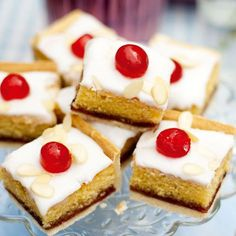 Take the classic bakewell tart recipe and make it into a tray bake in this recipe. A golden layer of shortcrust pastry topped with an almond cake, strawberry jam, icing and glacé cherries.