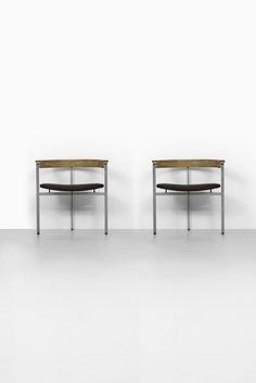 Poul Kjærholm PK-11 armchairs at Studio Schalling