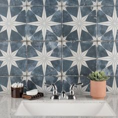 EliteTile Imported from Spain, our tile radiates old-world European elegance. This encaustic-inspired tile features a unique, low-sheen glaze in faded tones with centered antique white star patterns in each square. Designed by interior architect and furniture designer Francisco Segarra, this tile is a true reflection of vintage industrial design. Realistic imitations of scuffs and spots that are the marks of well-loved, worn, century-old tile bring rustic charm to any interior setting. These… Wall And Floor Tiles, Wall Tiles, Cement Tile Backsplash, Cement Tiles, Tiling, Kitchen Flooring, Entryway Flooring, Kitchen Tiles, Kitchen Countertops