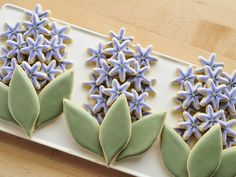 You can create those gorgeous hyacinth cookies using leaf and snowflake cookie cutters. Learn how to decorate from Amber at sweetambs.