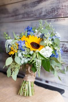 Sunflowers, blue hydrangea, seeded eucalyptus, burlap & pearl pins, rustic bouquet // Caley Newberry Photography