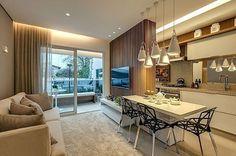 Decorados são formas úteis de visualizar tendências de #decor no seu futuro lar. Aqui, Sabbatini Interiores explorou da melhor forma uma cozinha americana: a parede que divide a sala se tornou painel de TV e a bancada, mesa de jantar em laca branca | foto: reprodução #projetododia