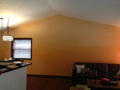 Ombré ole! My husband and I painted our living room wall 3 shades of orange. He used an airless sprayer to fade the colors together. The result looks like a desert sunset!
