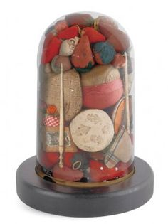 Collection of pin cushions and strawberries in cloche