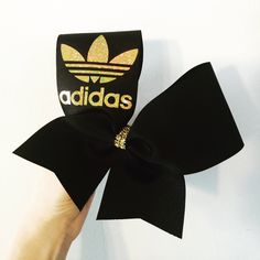 A personal favorite from my Etsy shop https://www.etsy.com/listing/569177766/black-and-gold-holographic-adidas-cheer