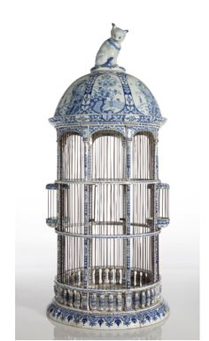 Antique bird cage with cat on top!