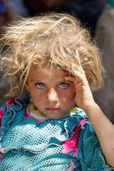 La petite yézidie aux yeux clairs du photographe Youssef Boudlal sacrée meilleure photo de lannée par Reuters