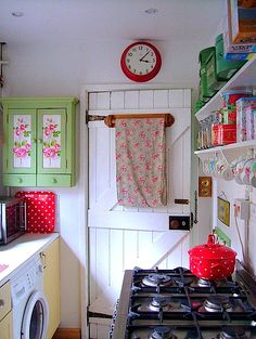 A Pretty Shabby Tiny Kitchen- but I wonder about venting the cooking fumes.