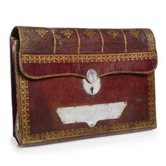 A silver-mounted, tooled and parcel-gilt red Morocco leather portefeuille the portefeuille 18th century, the mounts first half 19th century