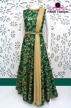 Emerald Green designer gown done up all along its expanse in heavy zari embroidery with shiny work at the neckline & waist belt in a telltale finish! Indian Attire, Indian Outfits, Indian Wear, Ethnic Fashion, Indian Fashion, Modern Fashion, Indian Designer Outfits, Designer Dresses, Green Color Combination Dresses