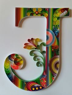Quilling letter J. Colorful. Filigrana.