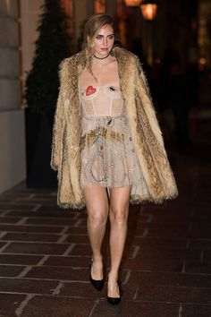 Chiara Ferragni is wearing a dress from Dior seen in the streets of Pari before the Dior Party on January 23 2017 in Paris France