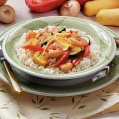 """Shrimp with Vegetables Recipe -Colorful sweet pepper, zucchini and yellow summer squash team up with tender shrimp in this delightful main dish. """"If you clean the shrimp and slice the vegetables the night before, it makes a quick weeknight meal,"""" notes Beth Woodard of Jamestown, North Carolina. """"It's my husband's favorite stir-fry."""""""