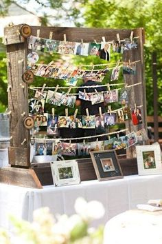 Charming photo display for an adult birthday party. Made to look rustic with old boards and clothesline style, hanging the pictures with clothespins.