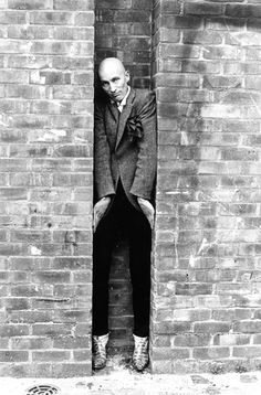 Richard O'Brien, 1984 'He has got the most marvellous head,' said Jane. 'But I decided I wouldn't do a head-only shot because it was just too obvious. It was his idea to go outside and around the back of the theatre. He somehow squeezed himself into the niche and I took the picture: it was bizarre and brilliant, and I enjoyed having the opportunity to do something a little more eccentric' - Jane Brown: A life in photography: In Pictures
