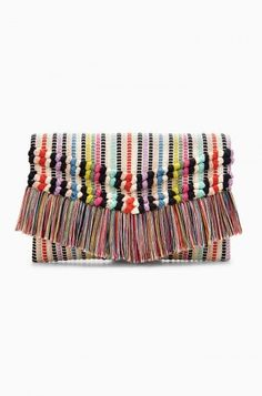 This boho inspired colorful fringe trimmed clutch is the ultimate summer purse. Shop cute clutches at Stella & Dot today. #designerclutches