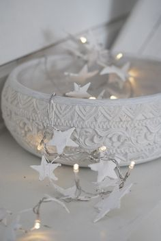 white bowl with stars and fairy lights