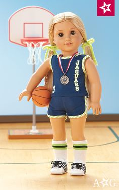 Julie's Basketball Uniform for 18-inch Dolls shown with Julie's Basketball Accessories. Uniform: Julie's ready to get out on the court and take on the competition in her team's basketball uniform $34. Julie's Basketball Accessories includes: • An adjustable basketball hoop • A basketball • A medal for when hard work pays off $38.